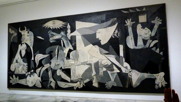 People look at the Guernica painting by