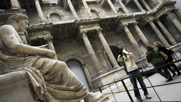 A man takes pictures of the statue of a