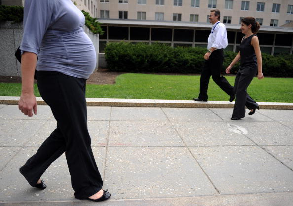 A pregnant woman due in six weeks walks