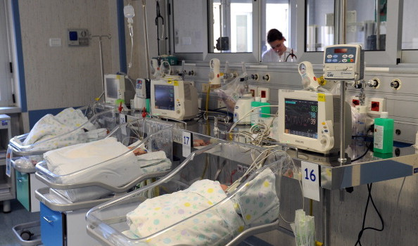 Babies rest in beds at the Bambino Gesu