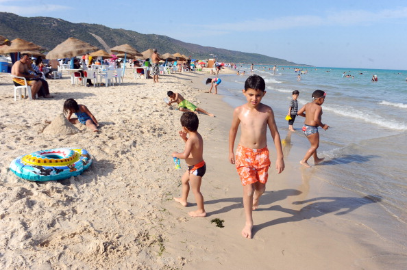 Children play on the beach in the Ghar E