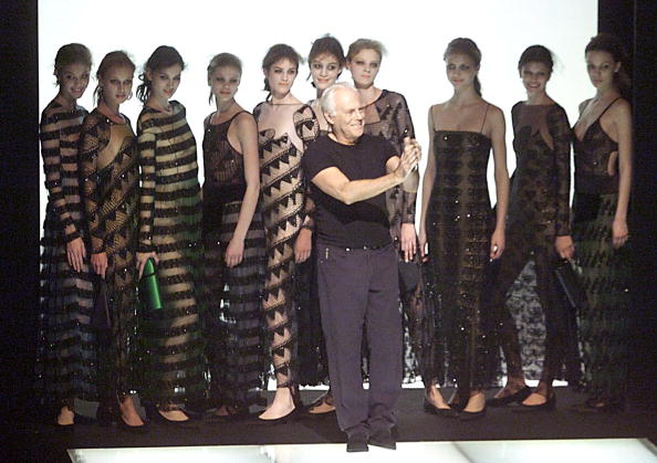 Italian designer Giorgio Armani, surrounded by his