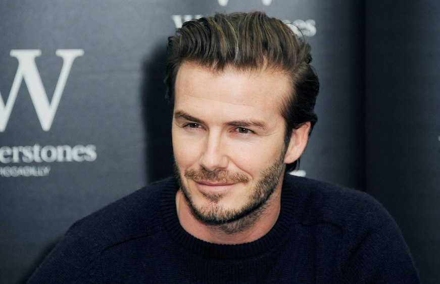 LONDON, UNITED KINGDOM - DECEMBER 19: David Beckham meets fans and signs copies of his new self titled book at Waterstone's, Piccadilly on December 19, 2013 in London, England. (Photo by Stuart C. Wilson/Getty Images)
