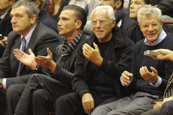 Fashion Designer Giorgio Armani (2nd R)