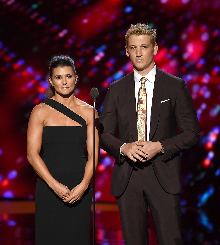 LOS ANGELES, CA - JULY 13: NASCAR driver Danica Patrick (L) and actor Miles Teller speak onstage during the 2016 ESPYS at Microsoft Theater on July 13, 2016 in Los Angeles, California.  (Photo by Kevin Winter/Getty Images)