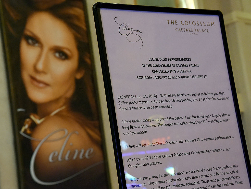 The marquee at Caesars Palace shows a tribute to Rene Angelil under an image of his wife, singer Celine Dion, on January 14, 2016 in Las Vegas, Nevada. Angelil died this morning of throat cancer at age 73.
