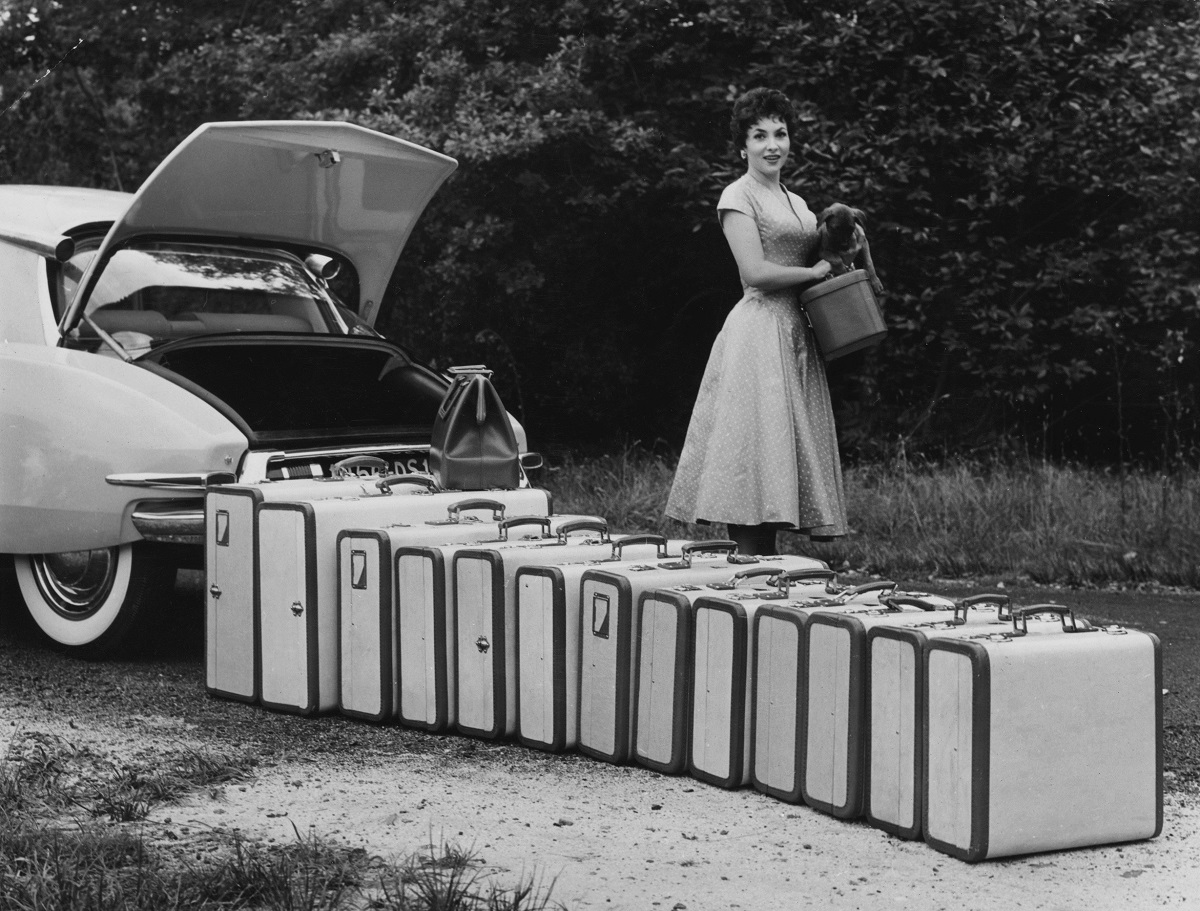 1955:  Italian film actress Gina Lollobrigida standing beside a row of suitcases which amazingly all fit into the boot of a Citroen DS 19.  (Photo by Charron/Hulton Archive/Getty Images)