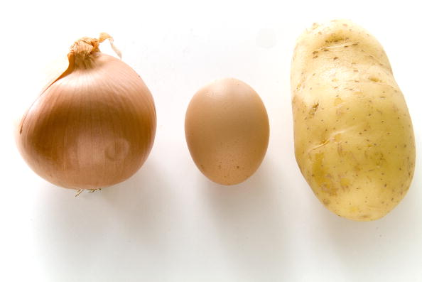 Elaboration of the Spanish omelette: Ingredients: Onions, egss and potatoes.