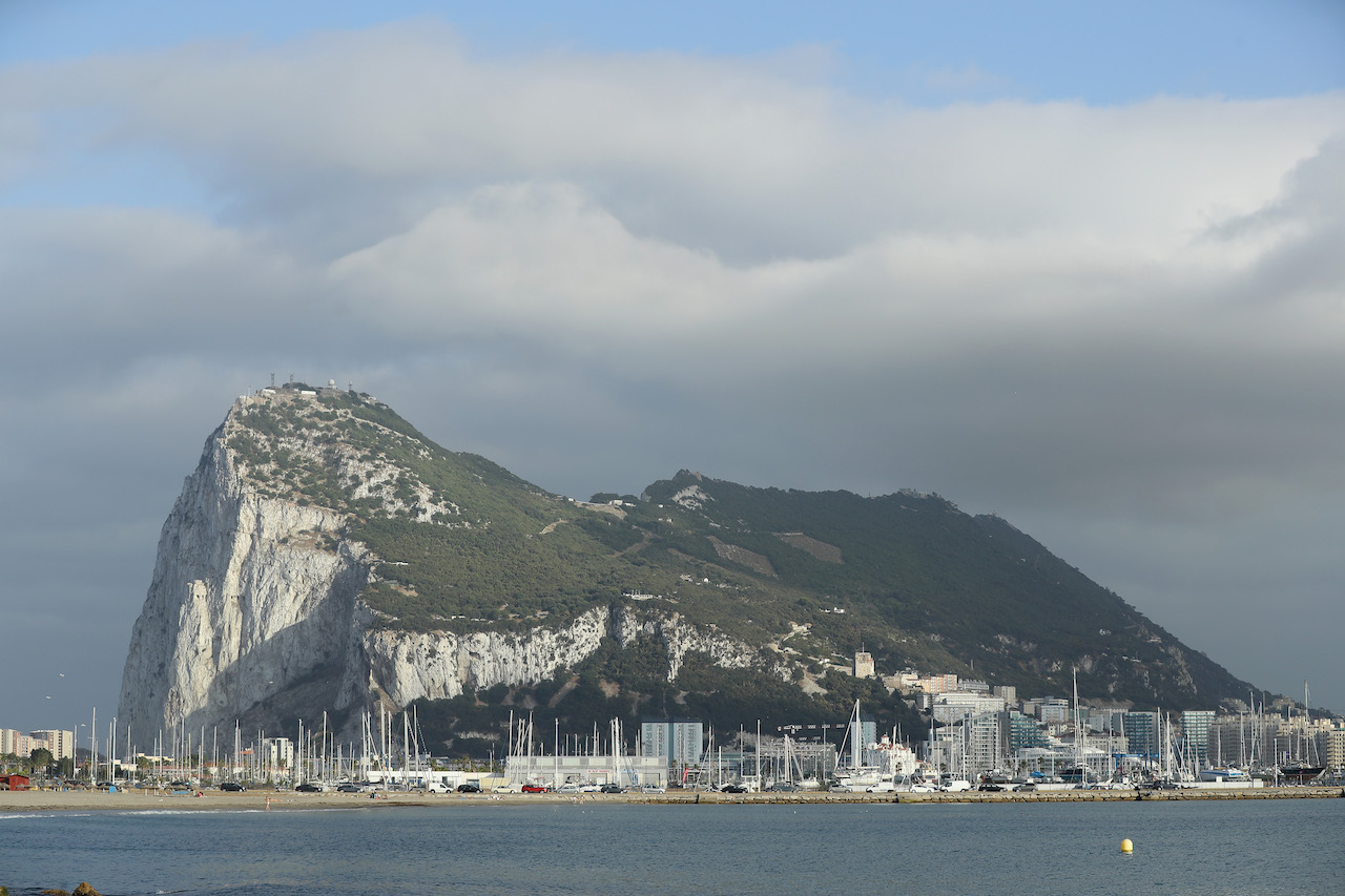 LA LINEA DE LA CONCEPCION, SPAIN - JUNE 22:  The British territory of Gibraltar looms behind beaches the day before the EU Referendum on June 22, 2016 in La Linea de la Concepcion, Spain. Citizens of the United Kingdom and its territories will go to the polls tomorrow in what many expect to be a very tight vote on whether to remain in or leave the European Union. A result is expected early Friday morning.  (Photo by Sean Gallup/Getty Images)