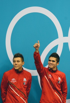 Ivan Navarro Garcia and German Sanchez Sanchez of Mexico celebrate winning the Silver medal during the Men's Synchronised 10m Platform final as part of the London 2012 Summer Olympic Games, Aquatic Centre, London