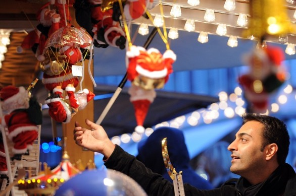 A man looks at Christmas decorations on