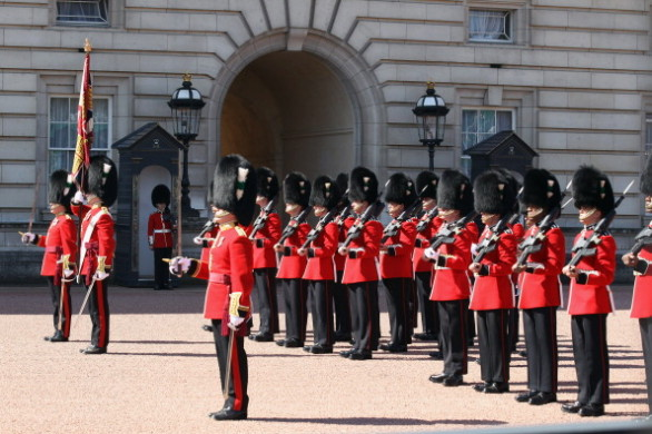 Visitors To London Watch The Changing The Guard At Buckingham Palace