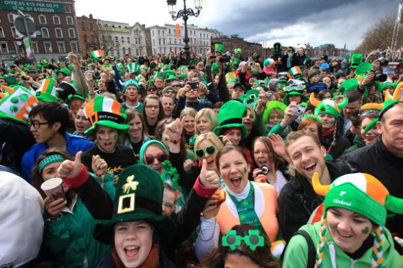 Parade goers shout as they watch St Patr