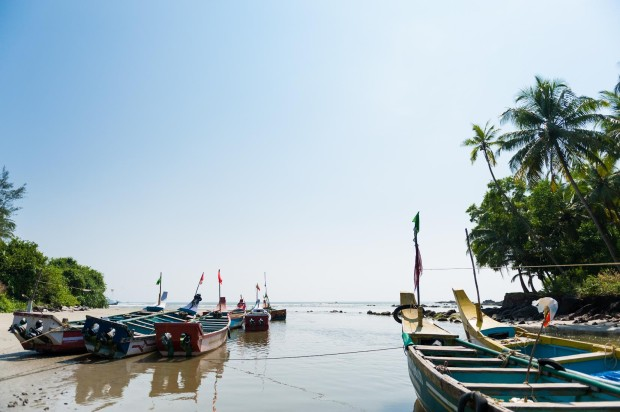 Wooden outrigger fishing boats in India; Shutterstock ID 126746486