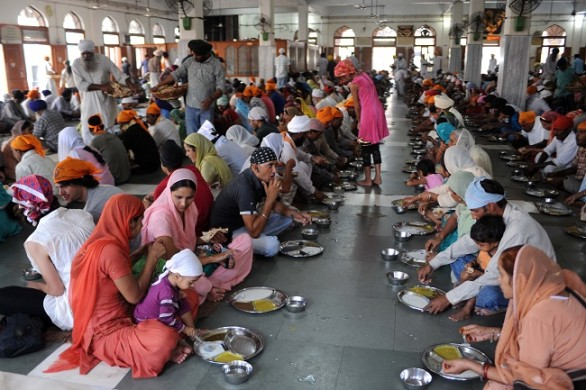 """Indian devotees eat free food during """"Wo"""