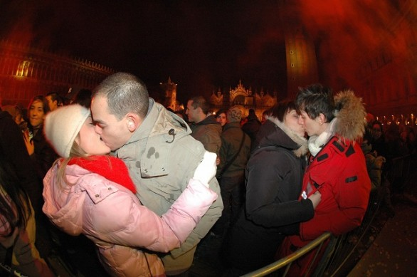 Couple kiss in front of Saint Mark's Bas